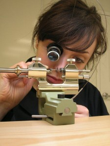 Roman Jewelers' watchmaker, Anna working on repairing a watch