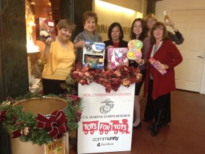 Roman Jewelers staff next to donation bin for toys for tots