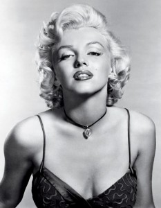 Black and white photo of Marilyn Monroe wearing a yellow diamond