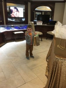 Kid standing with with a gift bag in Roman Jewelers