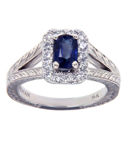 Custom sapphire engagement ring surrounded by diamonds