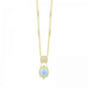 Yellow Sterling Silver And 14 Karat Matte' Necklace with blue stone.